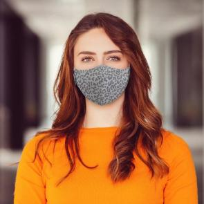 Woman wearing grey coloured leopard pattern face mask