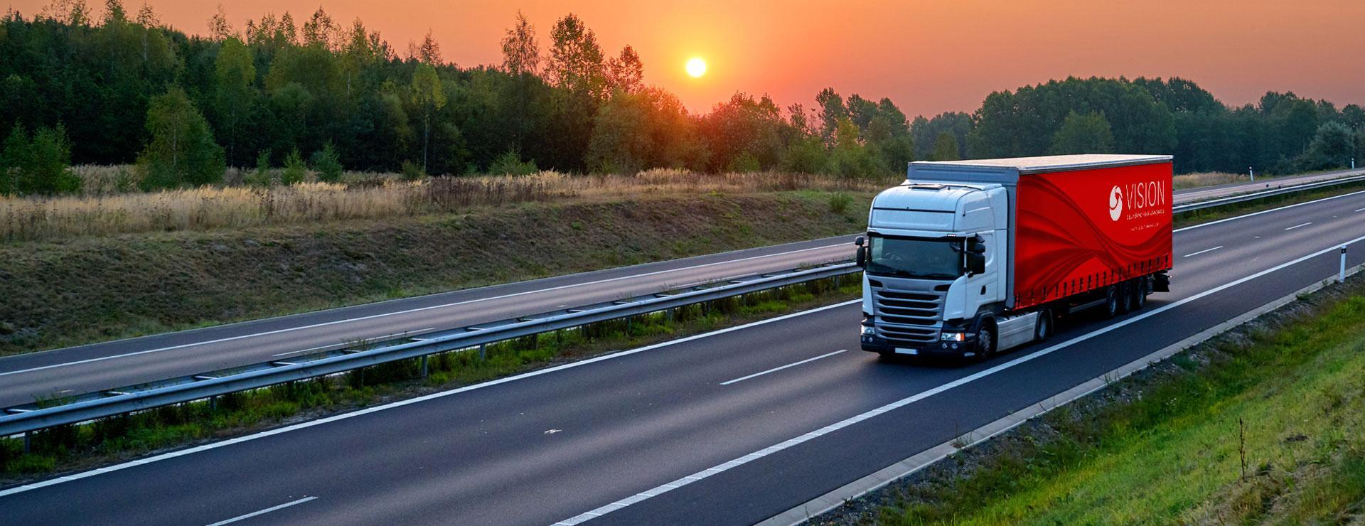 Truck transporting goods on motoroway