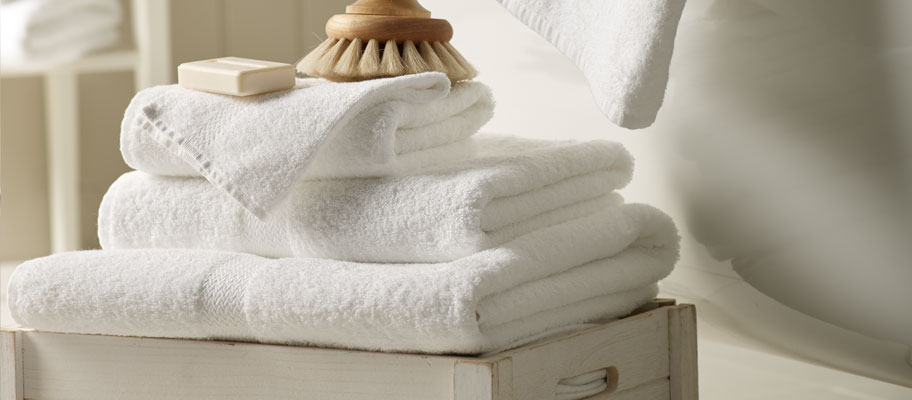 Hotel quality towels stacked and accessories