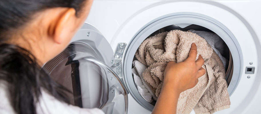 Housekeeper washing hotel quality towels