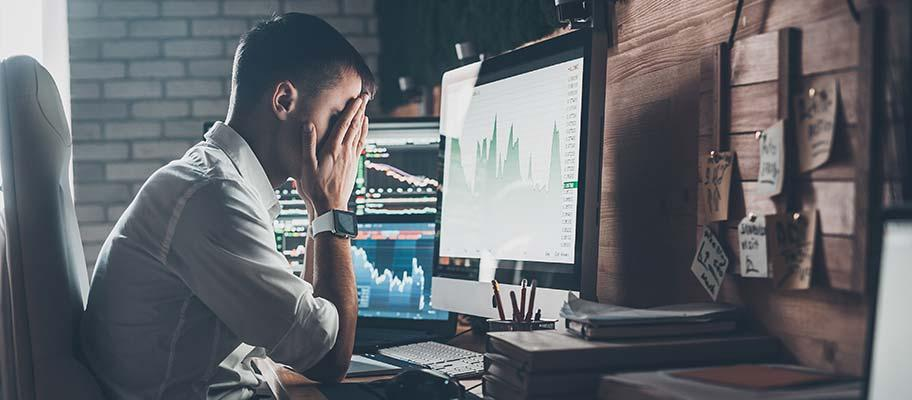 Man sitting at desk while stressed